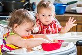 Two Babies Eat Breakfast