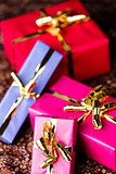 Four Wrapped Gifts with Golden Bows