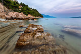 Rocky Beach and Transparent Adriatic Sea near Omis in the Evenin