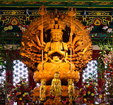 Thousand hands wooden Buddha in Chinese temple,Thailand