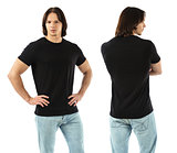 Muscular man wearing blank black shirt