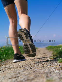 Legs and shoes of a woman jogger