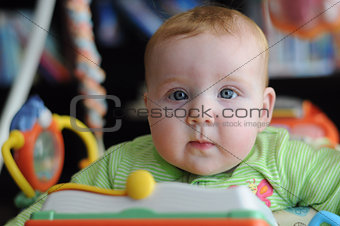 Close-up portrait of cute baby in play gym toy