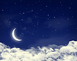 Moon and stars in a cloudy night blue sky
