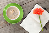 Blank notepad, coffee cup and orange gerbera flowers
