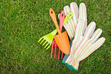 Garden tools over green grass