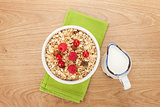 Healty breakfast with muesli, berries and milk