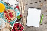 Healty breakfast with muesli, berries and orange juice