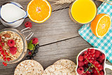 Healty breakfast with muesli, berries and orange juice