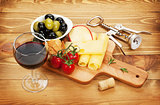 Red wine with cheese, olives, bread, vegetables and spices
