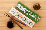 Sushi set with green tea and sakura branch