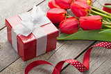 Fresh tulips bouquet and gift box