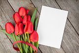 Fresh tulips bouquet and blank card for copy space