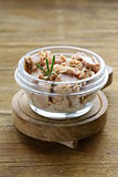 canned tuna with rosemary in a glass jar