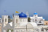 white greek church with blue roof on santorini island