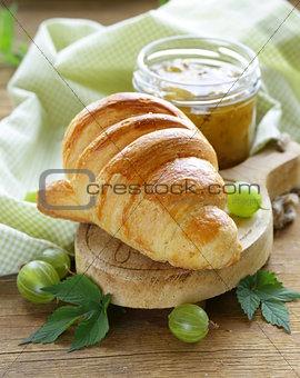Breakfast croissant with fresh jam of green gooseberry