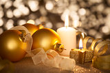 Golden Christmas background with candles, baubles and ribbons
