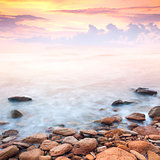 beautiful sunrise over the rocky sea coast