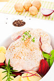 Raw chicken in baking dish.