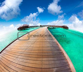 beautiful maldives  beach and water villa with fish-eye lens