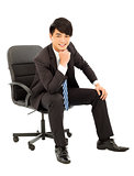Young smart business man sitting in a chair
