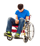 frustrated handicapped man sitting on a wheelchair