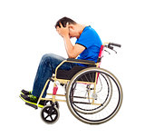 upset  and handicapped man sitting on a wheelchair