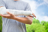 closeup of bandaged arm  in the park