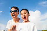 closeup of father and son are shouting in outdoors