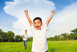 happy father and son playing in meadow
