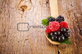 Fresh berries in wooden spoon