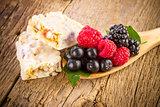 Muesli bars with fresh berries in spoon