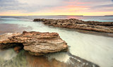 Soft pastel colours of a sunrise at Hyams Beach Australia