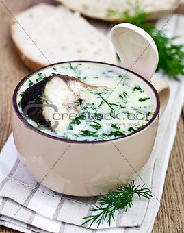 Fish soup in mug