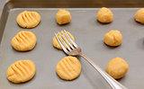 Flattening balls of cookie dough