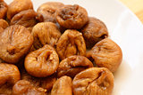 Soft dried figs on a white plate