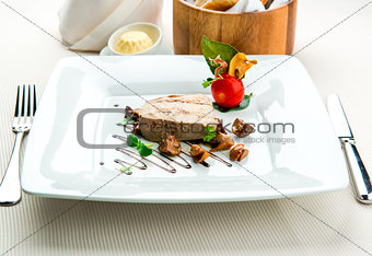 Sliced foie gras with sauce and chanterelle mushrooms