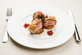 Roasted juicy beef steak with potato pancakes