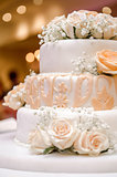 Beautiful wedding cake decorated with orange roses
