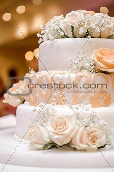 Beautiful wedding cake decorated with orange roses