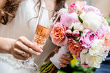 Beautiful bridal bouquet  and glass of champagne close-up