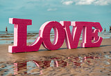 The word LOVE on the beach