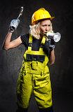 Attractive builder woman shouting through megaphone
