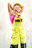 Female construction worker posing indoors