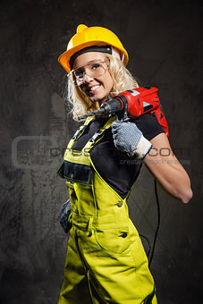 Attractive builder woman indoors