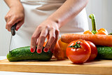 Woman cutting vegetables for a salad