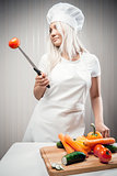 Woman cook with vegetables indoors, weight loss concept