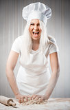 Angry and stressed out woman cook kneading dough
