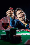 Poker player holding poker chip