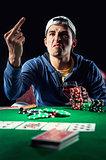 Aggressive young gambler indoors